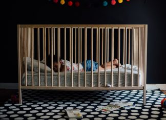 Baby on a wooden crib