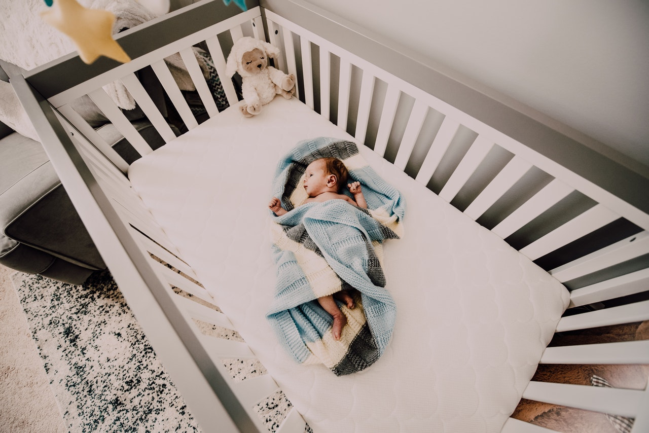 Baby on a white crib