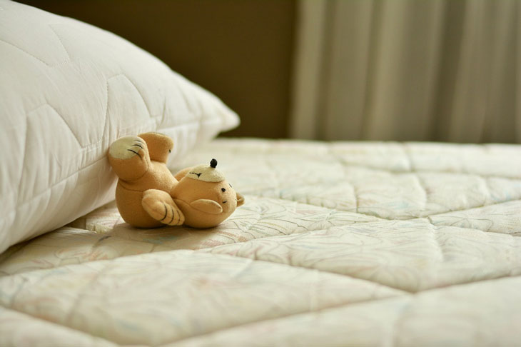 the matress and a little teddy bear